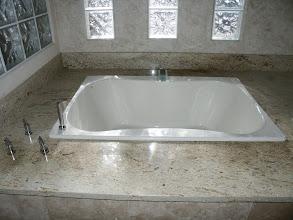 Photo: Soaking Tub, with new stone surround