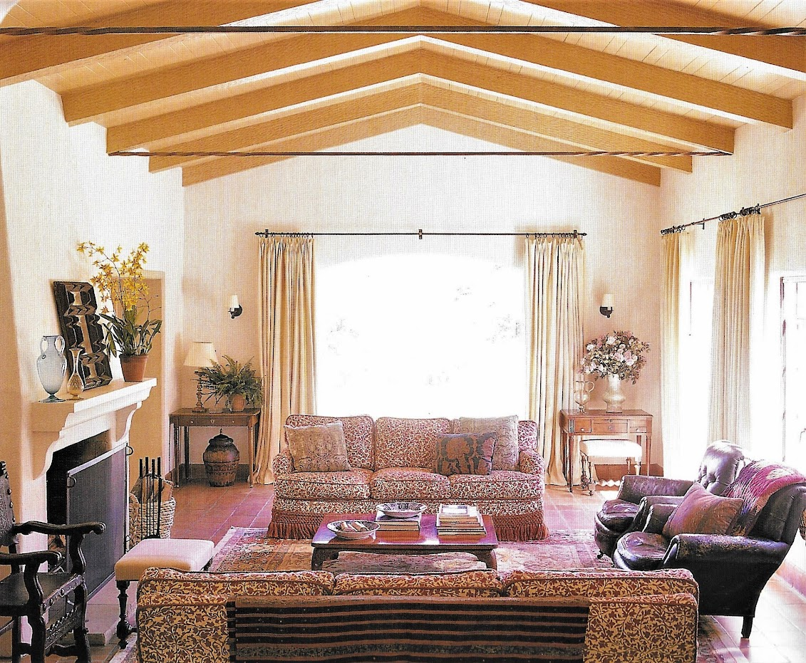 2002 cindy crawford decorated by michael s smith the sofas are covered in bennison the large window overlooks the pool the doors on the right open to