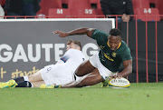 The Springboks and the Cell C Sharks winger S'busiso Nkosi scores a try during the international rugby match between SA and England at Ellis Park, Johannesburg on 09 June 9 2018.
