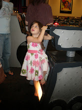 Photo: the bday girl climbs on the video camera