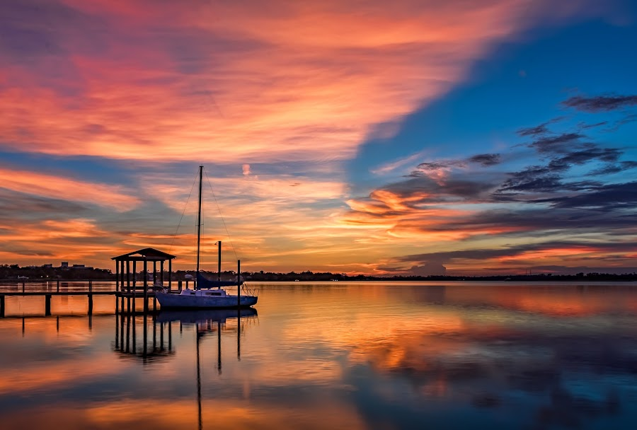 Beautiful Biloxi Back Bay Sunset by Don Young - Landscapes Sunsets & Sunrises ( sailboat, waterscapes, nature, waterscape, reflections, sunset, clouds, water, colors, boat,  )