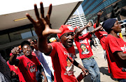 Supporters of Nelson Chamisa's opposition Movement for Democratic Change (MDC) party march through the streets to attend the party's final election rally in Harare, Zimbabwe, July 28, 2018.