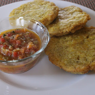 Green Plantain Pancake w/ Cheese and Tomato Scallion Sauce (Arepa de Platanos Verde con Queso y Salsa de Tomate y Cebolla)