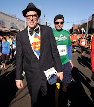Photo: MANCHESTER 11/28/13 Costumes at the Manchester Road Race are always fun to watch. Clark Kent (AKA Superman) was a runner this year. (MRR Photo by John Long)