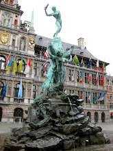 Photo: The Brabo fountain, depicting the legend of the founding of Antwerp (Roman soldier cutting off and throwing a mean giant's hand).