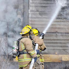 Firemen working on train fire by Martin Wheeler - People Professional People ( firemen first responders water fire smoke train emergency emergancy,  )