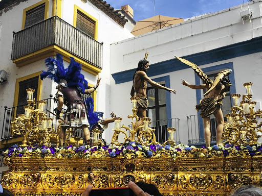 Faith afloat: A paso featuring a figure of Jesus Christ and Roman centurions glides through the Calle Resolana in Seville, Spain, during the Semana Santa (Holy Week). The city is a hive of festivities and a repository of historical relics. Picture: MADELEINE MORROW