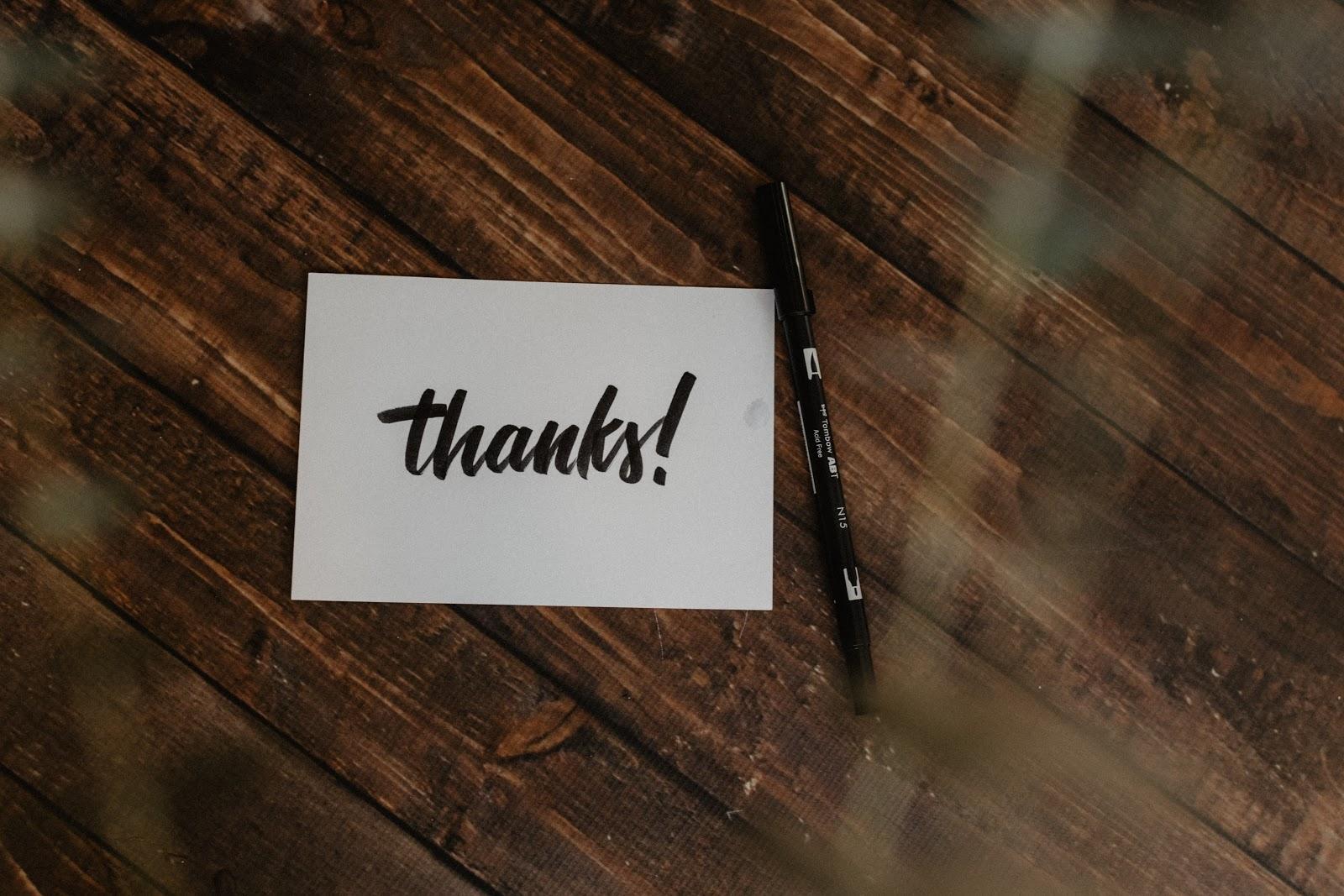 Thanks! on a customer service card