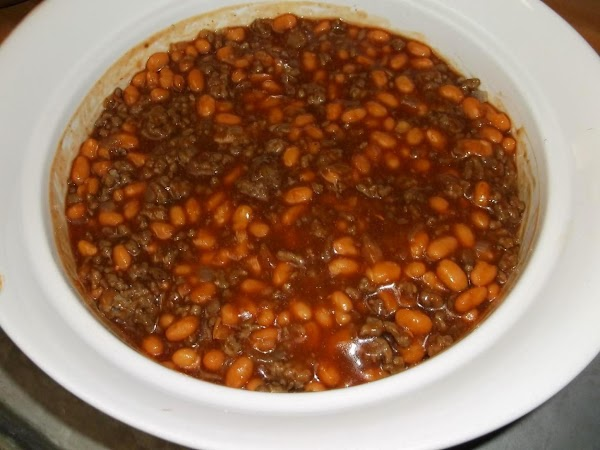 Fold the partially drained beans into the mixture.