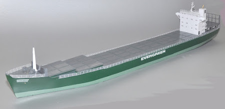 Photo: This is a production version of a 2nd Gen container ship, about 500' feet long with a capacity of about 1000 TEUs. They were ocean-going vessels that still serve as feeder ships.