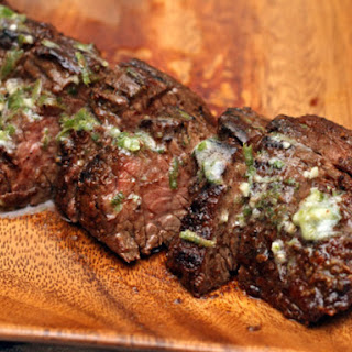 Grilled Chipotle-Rubbed Steaks with Lime Butter.