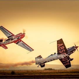Risky Maneuver by Hannes Kruger - Transportation Airplanes ( airshow, airplane, sunset, smoke, acrobatics )