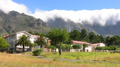 High School in District 6 with cloud-covered Table Mountain in background