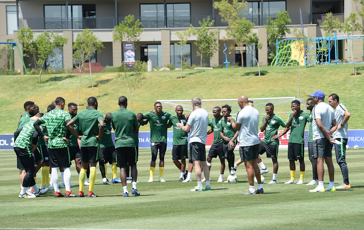 Bafana Bafana coach Stuart Baxter and his assistants in a discussion with the player during a training session at Steyn City School in Fourways, north of Johannesburg, on October 9, 2018. SA take on Seychelles in the 2019 Africa Cup of Nations at FNB Stadium in Soweto on Saturday October 13 2018.