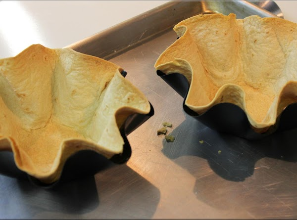 Bake tortilla shells according to the directions on the mini tortilla shell molds. Or...