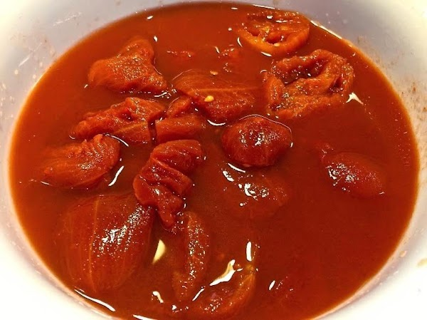 Pour tomatoes, add paprika, 2 tsp. salt, Tabasco; cover, simmer 30 minutes.