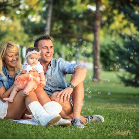 Young and happy family by Sabin Malisevschi - People Family ( child, girl, family, infant, parent, young, newborn,  )