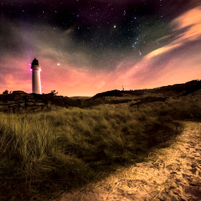 Pathway to the light by Lorraine Paterson - Landscapes Beaches ( clouds, dark, lighthouse, long exposure, night, beach, photography )