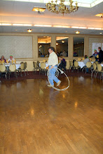 Photo: Lou Salazar, Local 525, tries a cow dance that starts with a dosey doe.  Cow doesn't dance.