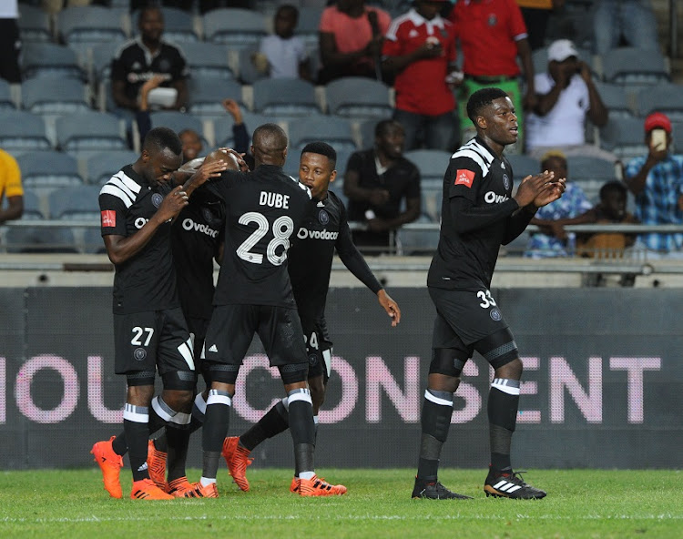 Luvuyo Memela of Orlando Pirates celebrates a goal with teammates.