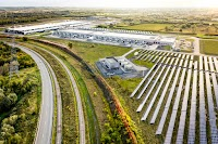 The sun shines over the Google solar field at our St. Ghislain, Belgium data center.