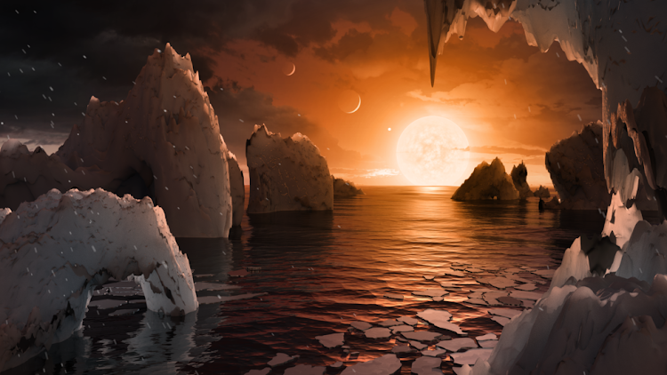 This illustration shows the possible surface of TRAPPIST-1f, one of the newly discovered planets in the TRAPPIST-1 system. Scientists using the Spitzer Space Telescope and ground-based telescopes have discovered that there are seven Earth-size planets in the system. Illustration: NASA