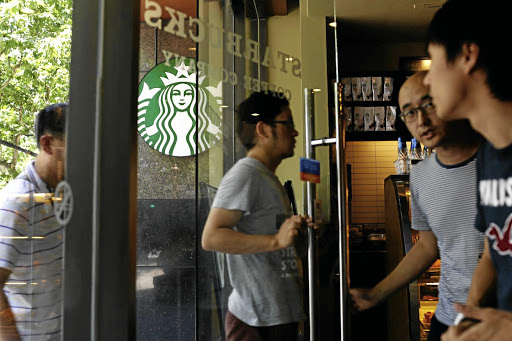 Customers enter a Starbucks store in Shanghai in this file picture. The US company could become subject to restrictions if tension snowballs into a trade war. Picture: REUTERS/ALY SONG/FILE PHOTO