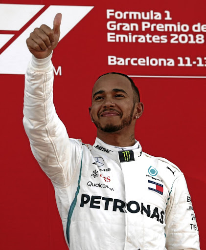 Good day at the office: Lewis Hamilton acknowledges fans after winning Sunday's Spanish Grand Prix with a commanding performance behind the wheel of his Mercedes. Picture: REUTERS
