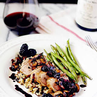 Seared Pork Tenderloin and Sage Caramelized Mushrooms with Blackberry Red Wine Reduction.