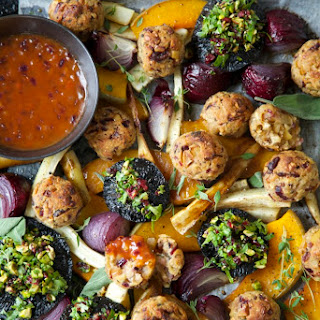 Vegetarian or Vegan Roast with Cranberry, Sage and Cashew Nut Stuffing Balls and Tomato Onion Gravy.