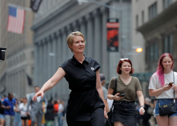 "Cynthia Nixon, former ""Sex and the City"" star and current candidate for governor of New York, walks on Wall St. following a campaign event in New York on August 22 2018."