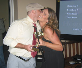 Photo: Lady Luck wins the trophy and a kiss!