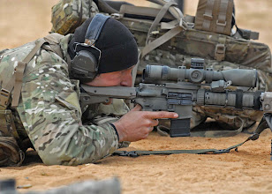 """Photo: 101207-A-4136D-033 A sniper prepares to engage a target during the 2010 USASOC Sniper Competition at Fort Bragg. """"Leading into the competition, I knew this course would be challenging,"""" said Sgt. 1st Class Charles Zalewski, a sniper with 5th Special Forces Group. """"All the events in the competition encompassed multiple challenging task that we have to be expected to do as snipers."""""""