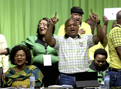 HEAVYWEIGHTS Baleka Mbethe and Sihle Zikalala sing along with delegates  at the ANC's provincial general council in Durban on Monday   Picture: Jackie  Clausen