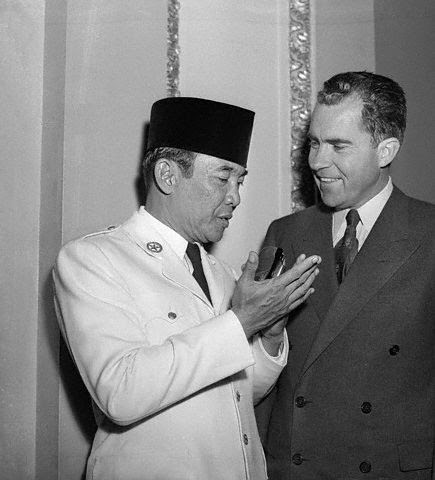 "Photo: 18 May 1956, Washington, DC, USA --- Visiting president chats with ""veep.""  Washington, D.C.:  President Achmed Sukarno of Indonesia, currently on an 18 day official visit to the United States, is shown (left) chatting with Vice President Richard Nixon shortly before a capitol luncheon given in his honor by Mr. Nixon yesterday.  The visiting chief of state also addressed a joint session of Congress yesterday, an honor accorded only to leaders of key nations. --- Image by © Bettmann/CORBIS"