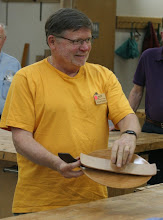 Photo: Here Richard shows the trick to turning his oval plate.