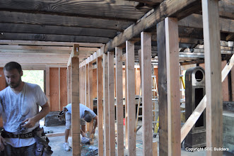 Photo: Erik and Lance replacing the 6x6 girders and 6x6 girder post.