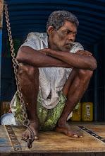 Photo: Resting after unloading the vegetable trucks Pettah Market Colombo Sri Lanka