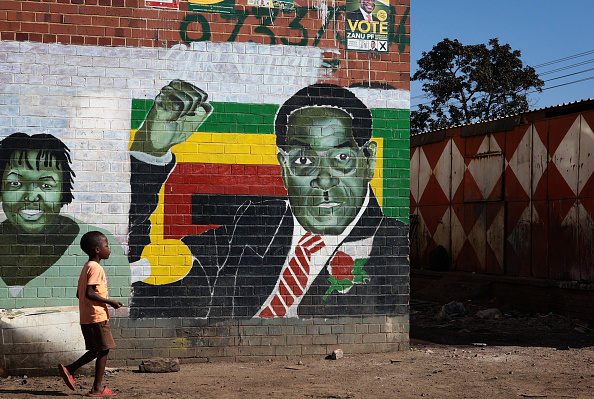 Mugabe' greeted polling officers' but did not speak to the throngs of journalists gathered at the polling station to witness him casting his ballot.