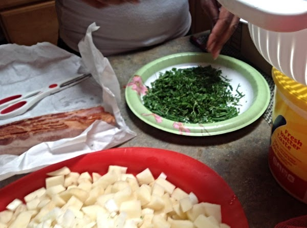 Stir with a large wooden spoon and then add the chopped herbs and stir...