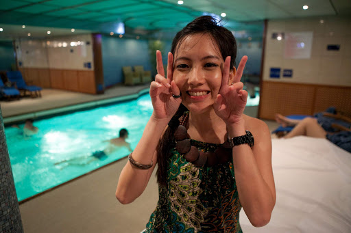 costa-cruises-passenger.jpg - A passenger in front of an interior pool on Costa Cruises.