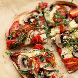 Personal Vegan Tortilla Pizza with Homemade Mozzarella, Mushrooms, Tomatoes & Basil.