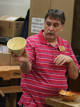 Photo: Tim Aley shows his white box elder bowl with spray lacquer finish.