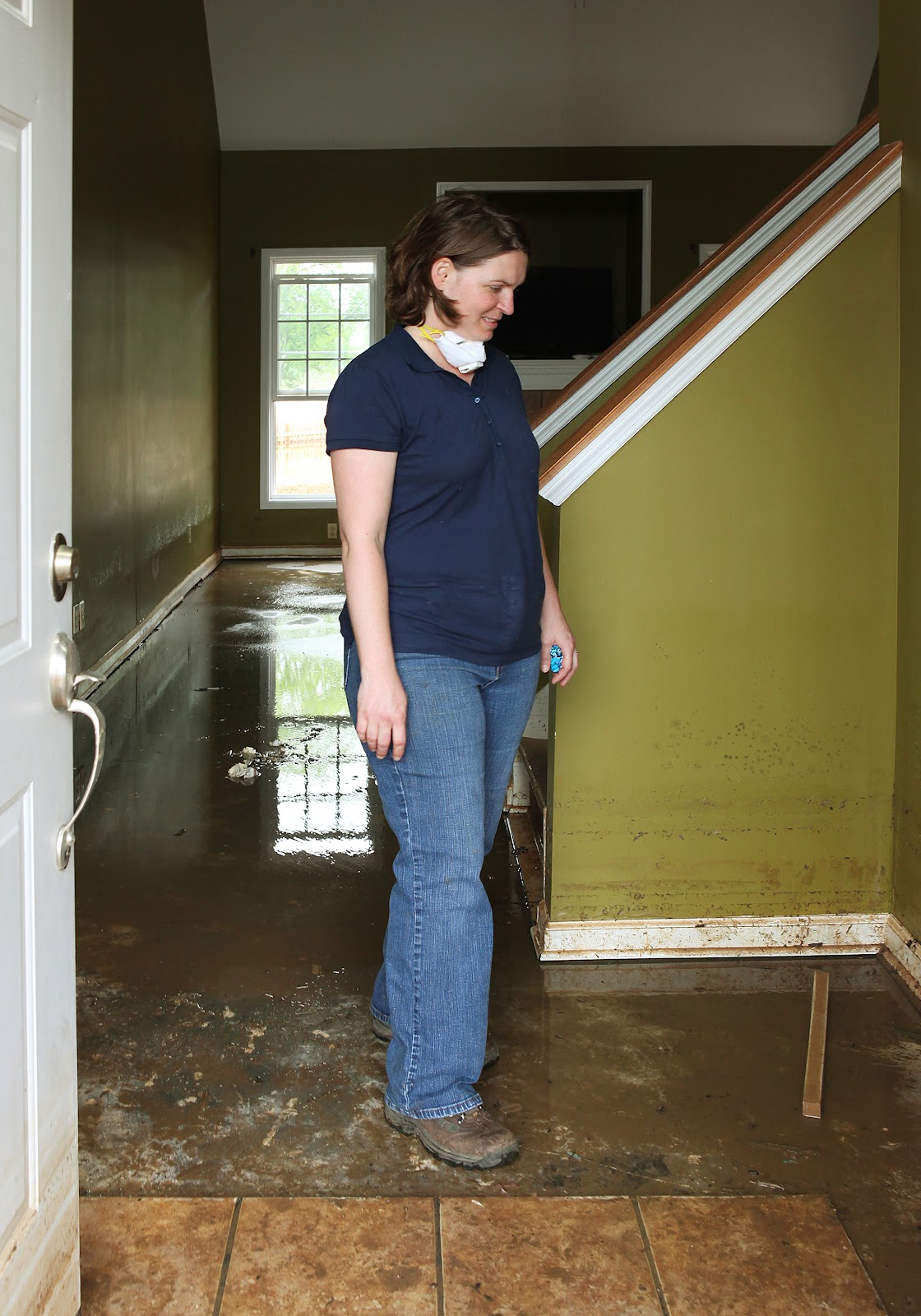 FEMA_-_44084_-_Resident_of_Clarksville_surveying_her_flood_damaged_home.jpg
