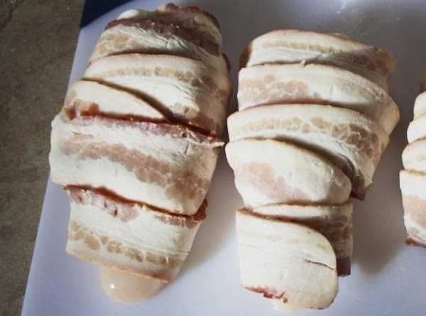 wrap each wedge center to center (around) with a 1/2 piece of bacon, top...