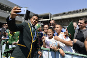 Springbok player Elton Jantjies meet fans during the South African national men's rugby team official send-off at OR Tambo International Airport on August 30, 2019 in Johannesburg, South Africa.