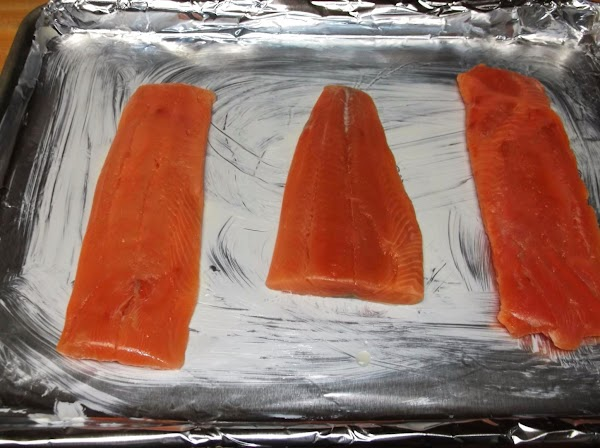 Remove salmon from packaging (drain if necessary.) Place salmon on prepared baking sheet.