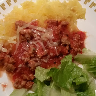 Homemade Italian Sausage with Pasta Sauce and Spaghetti Squash.
