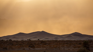 Photo: Dist storm Sunday evening over Mesquite Flat Dunes, as seen from from Devil's Cornfield.