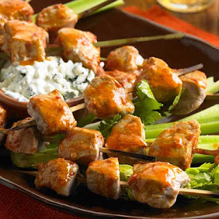 Buffalo Pork Skewers With Blue Cheese Sauce.